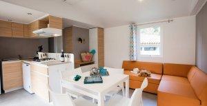 Cottage Suite Privilège coin séjour et cuisine location